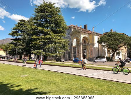 Luino, Lombardy, Italy - April 30, 2019: People Walking Along The Luino, Lakefront On The Coast Of L