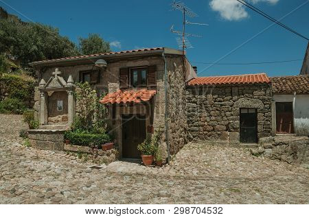 Deserted Alley And Charming Old Small House With Stone Niche For Saints, In A Sunny Day At Belmonte.