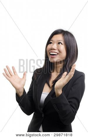 Happy Asian woman looking up and arms out, isolated on white.