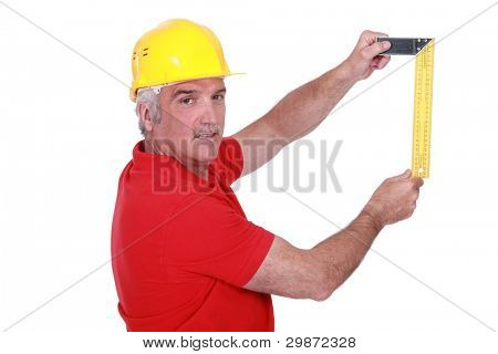 portrait of mature carpenter with meter isolated on white