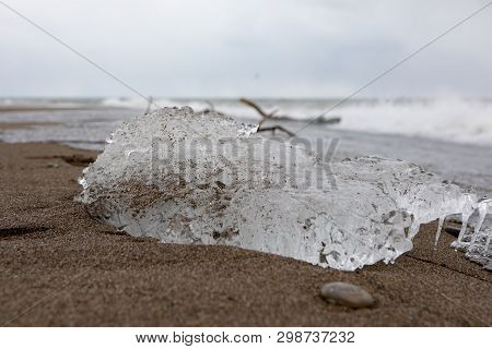 Abstract Outdoor Elements Frozen Ice Block Sandy Beach Trail Waves Background