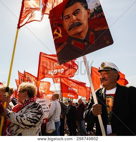 Orel, Russia, May 01, 2019: Labor Day Celebration. Senior Man With Stalin Portrait Smiling Against C