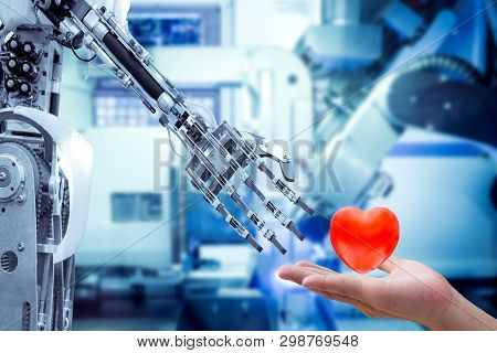 Concept Image Of Human Heart On Hand Send To A Robot For Make The Robots Have Feelings, Love, Like A