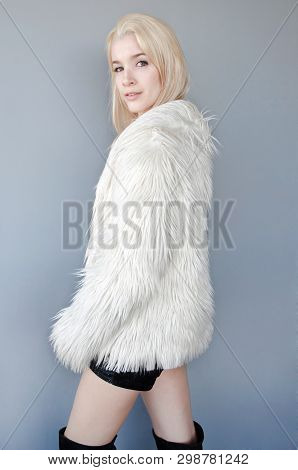 Beautiful Lady Dressed In White Fur Coat And Black Shorts