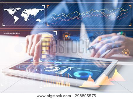 Stockbroker Working With Financial Information At Tablet Computer. Interactive Stock Market Tracking