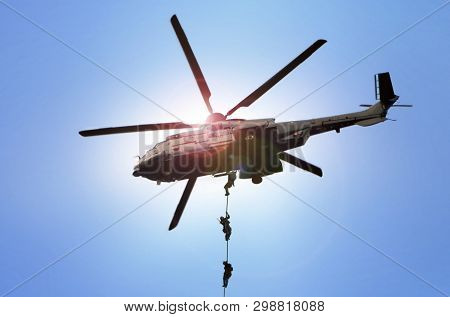Military Commando Helicopter Drops Under Bright Daylight