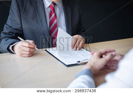 Employer Or Recruiter Holding Reading A Resume During About Colloquy His Profile Of Candidate, Emplo
