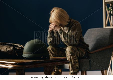 Close Up Portrait Of Young Female Soldier. Woman In Military Uniform On The War. In Doctors Consulta