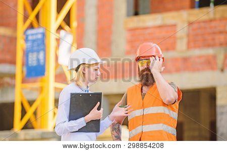 Safety Inspector Concept. Inspector And Bearded Brutal Builder Discuss Construction Progress. Constr
