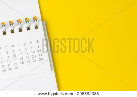 White Clean Calendar On Solid Yellow Background With Copy Space, Business Meeting Schedule, Travel P