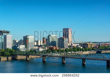Cityscape View Of Wonderful Downtown Portland, Oregon With The Hawthorne Bridge In The Foreground