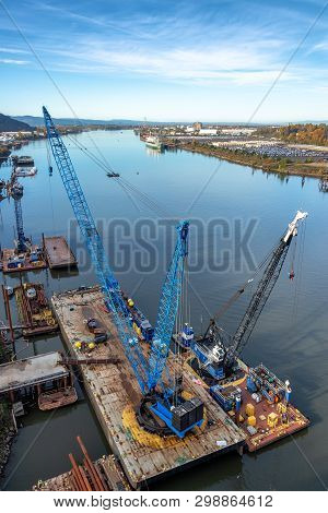 Floating Cranes On The Willamette River In Portland, Oregon