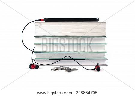 Concept Of Cheap Audio Books. Red Headphones And Mobile On The Stack Of Books. White Background With