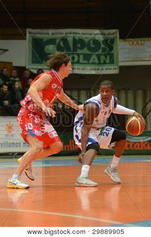 KAPOSVAR, HUNGARY - JANUARY 28: Kwadzo Ahelgebe (white 20) in action at a Hungarian Championship basketball game with Kaposvar (white) vs. Nyiregyhaza (red) on January 28, 2012 in Kaposvar, Hungary.