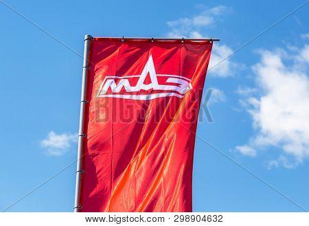 Samara, Russia - May 1, 2019: Dealership Flag Of Minsk Automobile Plant (maz) Over Blue Sky. Maz Is