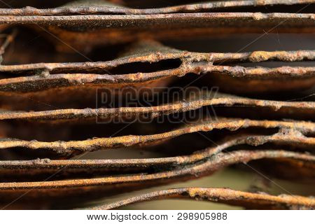 Picturesque Curved Sheets Of Rusty Metal. Curved Rusty Sheets Of Metal. Industrial Abstraction.