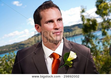 Groom And Corsage With Blue Water In The Background