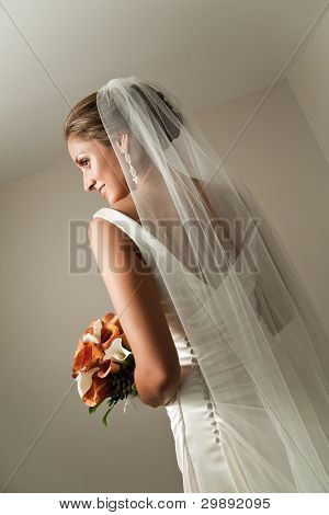 Beautiful Bride From Behind Showing Her Veil And Bouquet