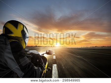 POV of super sport motorcycle driver riding alone on asphalt motorway. Outdoor photography. Travel and sport, speed and freedom concept