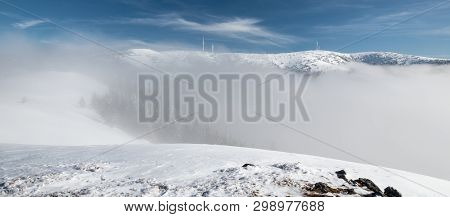 Krizava And Velka Luka Hills With Transmitter Above Mist Level From Skalka Hill In Winter Mala Fatra