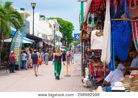 PLAYA DEL CARMEN,MEXICO - APRIL 14,2019 : Tourists and locals at the colorful 5th avenue, one of the main attractions in town