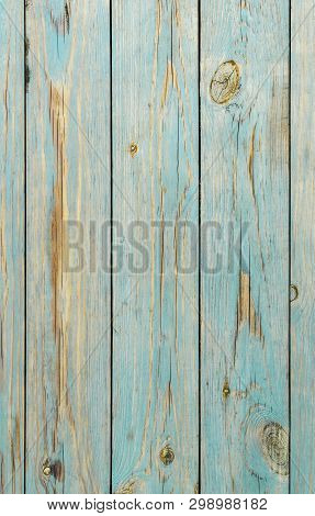 Faded Blue Wooden Planks Background. An Old Blue Wooden Fence. Blue Wooden Texture Great As Backgrou