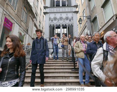 Lisbon, Portugal - March 17 2019:  People Under The Elevador De Santa Justa A 19th Century Lift In T