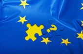 Euroscepticism - Detail of Silky Flag of Blue European Union EU Flag Drapery With Puzzle Piece With Question Mark poster