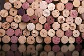 Wine corks background. Reflection on the glass poster
