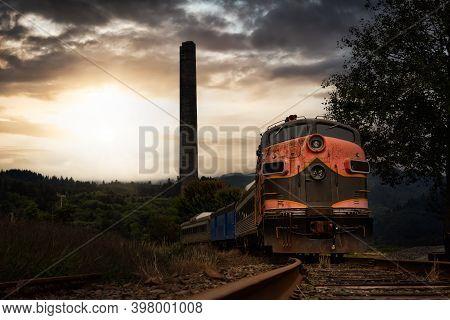 Old Rusty Train On The Railroad Tracks In A Small Town. Garibaldi, Oregon, United States. Dramatic S