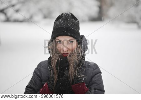 young woman in a snowy park