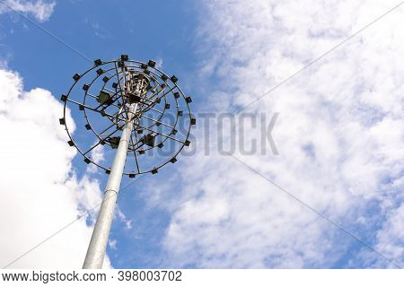 Spotlight And Beautiful Blue Clear Sky With White Clouds Background In Sunny Day And Copy Space. Nat