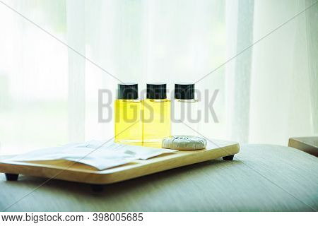 Glass Bottles Of Natural Cosmetic Oil On Top Wooden.