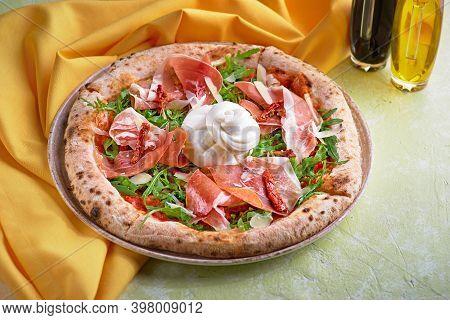 Food Concept. Fresh Original Italian Pizza With Burrata, Prosciutto And Arugula.