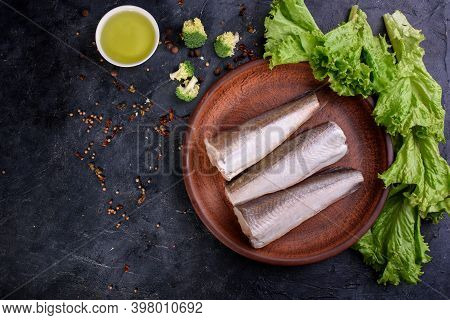 Lfresh Fish Notation On A Wooden Board, With Olive Oil, Sauce, Fresh Lettuce Leaves. Useful Food.