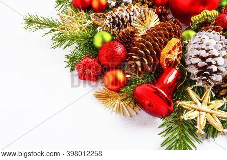 Christmas Decoration With Dried Orange Slices, Red Jingle Bell And Straw Star