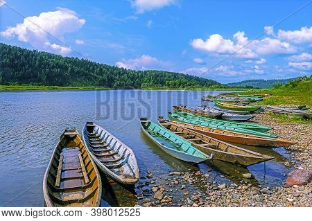Fishing Wooden Boats Moored To The Bank Of The River. Beautiful River Landscape.