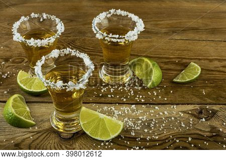 Gold Mexican Tequila With Lime And Salt . Tequila. Tequila Shot. Alcohol  Drink