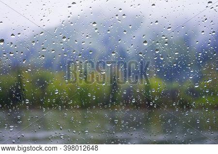 Lake View Through Window In Rainy Day. Rainy Day. Rain Drops. Rain Drops Background.