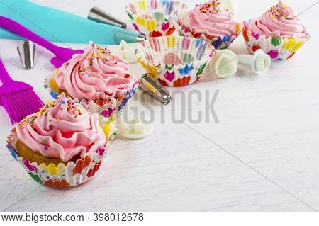 Making Pink Cupcakes. Birthday Cupcake With Pink Whipped Cream. Homemade Cupcakes Decorated For Part