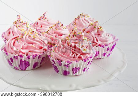 Pink Cupcakes. Birthday Cupcake With Pink Whipped Cream. Homemade Cupcakes Served For Party.