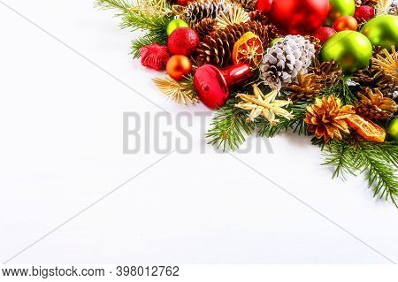 Red And Green Christmas Ornaments, Fir Branches And Cones . Christmas Decoration With Jingle Bell An