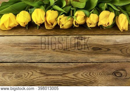 Yellow  Tulips On Wooden Background Copy Space. Spring Flowers. Flowers Postcard.  Flowers Greeting