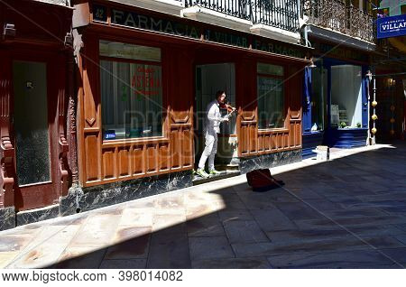 A Coruña, Spain. June 20, 2020. Violinist Playing On Main Street Or Calle Real.