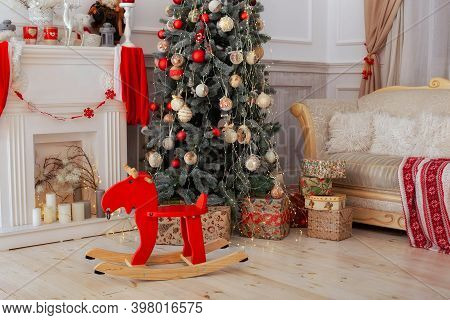 Christmas Interior Of Living Room With Decorated Christmas Tree, Fireplace And Gifts. Scandinavian I