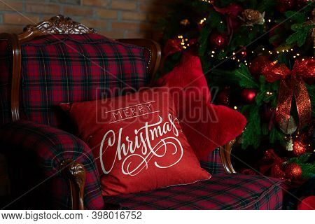 Close Up Christmas Red Pillow On Sofa. Decorated Living Room With A Christmas Tree. Interior Of Room