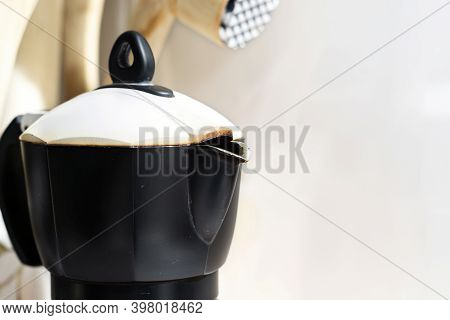 Detail Of The Spout Of The Black Coffee Pot With The White Lid In A Domestic Kitchen.making Coffee.