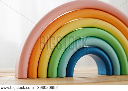 A Wooden Toy For A Child. The Rainbow Is Made Of Natural Wood. Colorful Details Of A Wooden Toy.