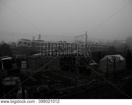 Chomutov, Czech Republic - November 27, 14:33 - Train In Foggy Autumnal City