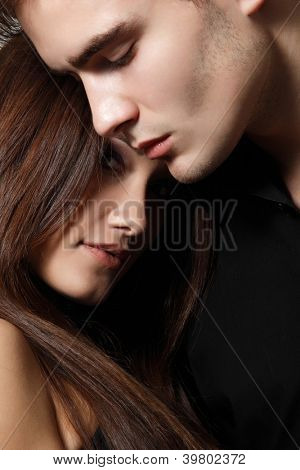 Sexy passion couple, beautiful young man and woman closeup, studio shot